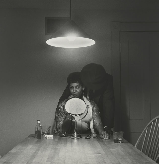 """Carrie Mae Weems, """"Untitled (Man and mirror),"""" from """"Kitchen Table Series"""" (1990), gelatin silver print, 27 1/4 x 27 1/4 in (69.2 x 69.2 cm) (Collection of Eric and Liz Lefkofsky, promised gift to The Art Institute of Chicago) (© Carrie Mae Weems) (photo © The Art Institute of Chicago) (click to enlarge)"""