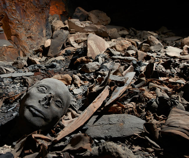Mummified remains among fragments of coffins, cloth, and shards: Tomb KV 40 was plundered several times and damaged by a fire. (photo by Matjaz Kacicnik, courtesy University of Basel/Egyptology)