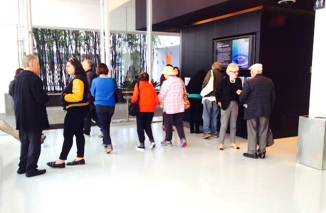 Mindful Awareness participants gathered outside the lecture hall after the event concluded.