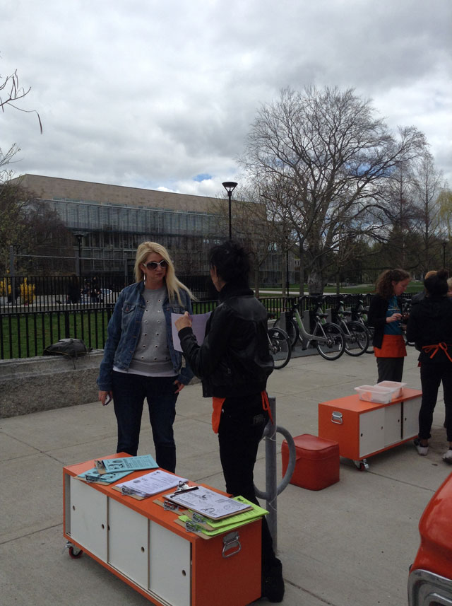 NannyVan workers giving out information in front of the Cambridge Library (click to enlarge)