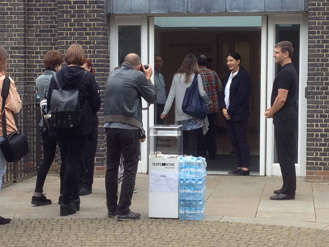 Abramović greeting visitors at the entrance to the Serpentine Gallery (all photos by the author for Hyperallergic unless otherwise noted)