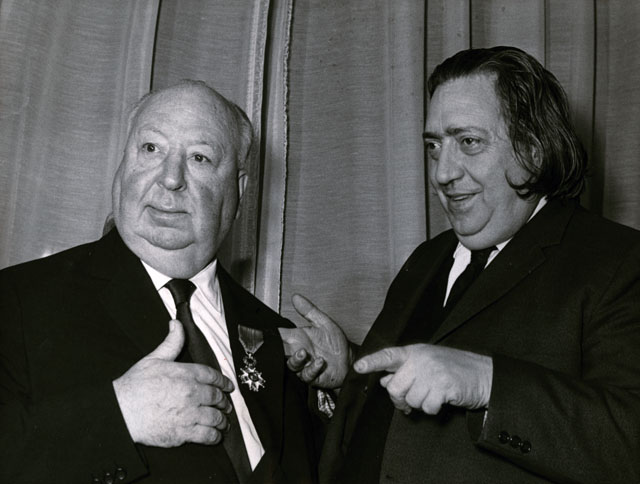 """Unknown Photographer, """"Henri Langlois (right) giving the Légion d'honneur to Alfred Hitchcock, January 14th"""" (1971) © SIPA."""