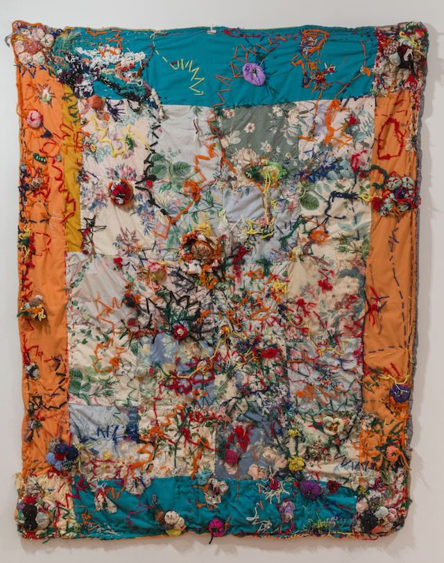 "Marie Roseman, ""Untitled (Throw)"" (c. late 1960s), yarn, sequins, thread, fabric, plastic beads, lame, pin cushion on quilt, 50 x 60 in (collection of Donald Roseman) (photo by Adam Reich, courtesy Studio Museum)"