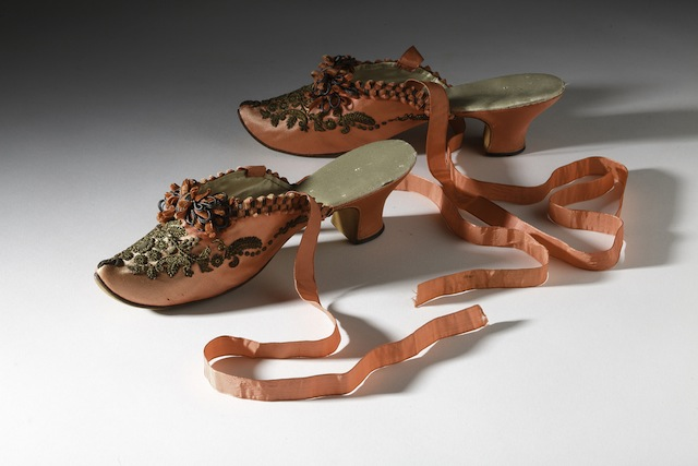 French, 1880 – 1885. The high heel was reintroduced into Western fashion in the late 1850s as part of the nostalgia for the 18th century dress that captured fashionable imaginations of the period. Along with this interest in 18th century came the specter of the licentious woman, this pair of boudoir slippers which features many hallmarks of 18th century mules, would have been perfect for this highly charged image of femininity. Collection of the Bata Shoe Museum Photo credit: Image © 2014 Bata Shoe Museum, Toronto, Canada (photo: Ron Wood)