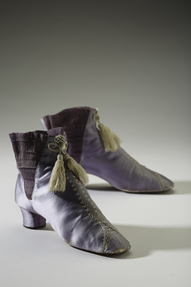 English, early 1860s. In 1856 when William Henry Perkins accidently invented mauve, the first synthetic dye, a new age of colour in fashion was born. Soon vibrant and often gaudy synthetic colours were the toast of fashion but many of these hues also came with risk to wearer. Arsenic and picric acid to name a few were just some of the toxic chemicals used in create coloured clothing. This pair of mauve boots shows the brilliance of the new synthetic colour. Collection of the Bata Shoe Museum Photo credit: Image © 2014 Bata Shoe Museum, Toronto, Canada (photo: Ron Wood)