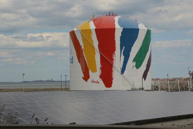 "Corita Kent's ""Rainbow Swash"" on a natural gas storage tank in Boston (photo via Ktr101/Wikimedia)"