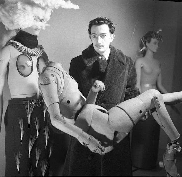 "A photograph by Denise Bellon, taken at the International Exhibition of Surrealism, shows Salvador with the lay figure he used as the chauffeur in ""Le Taxi Pluvieux"" (1938). (Image courtesy of Fonds Photographique Denise Bellon, Paris © Les Films de l'Équinoxe Fonds Photographique Denise Bellon © Salvador Dalí, Fundació Gala Salvador Dalí, DACS, 2014)"