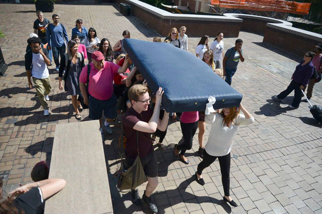 Fellow students organized by Carrying the Weight Together carrying the mattress for Emma Sulkowicz (photo via Carrying the Weight Together/Facebook) (click to enlarge)