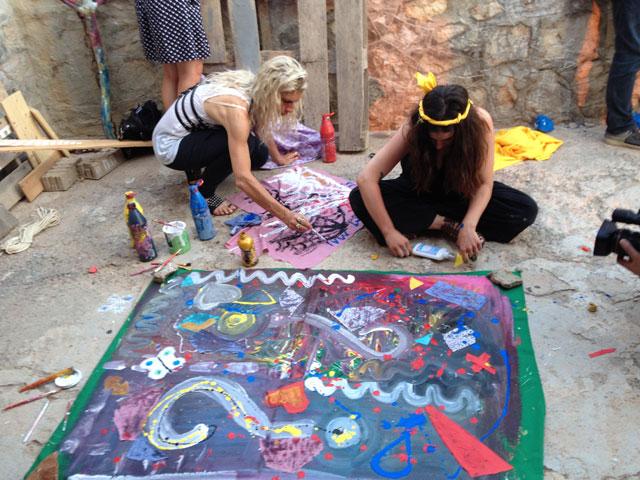 Visitors making art in Pawel Althamer's 'The Secret of the Phaistos Disc'