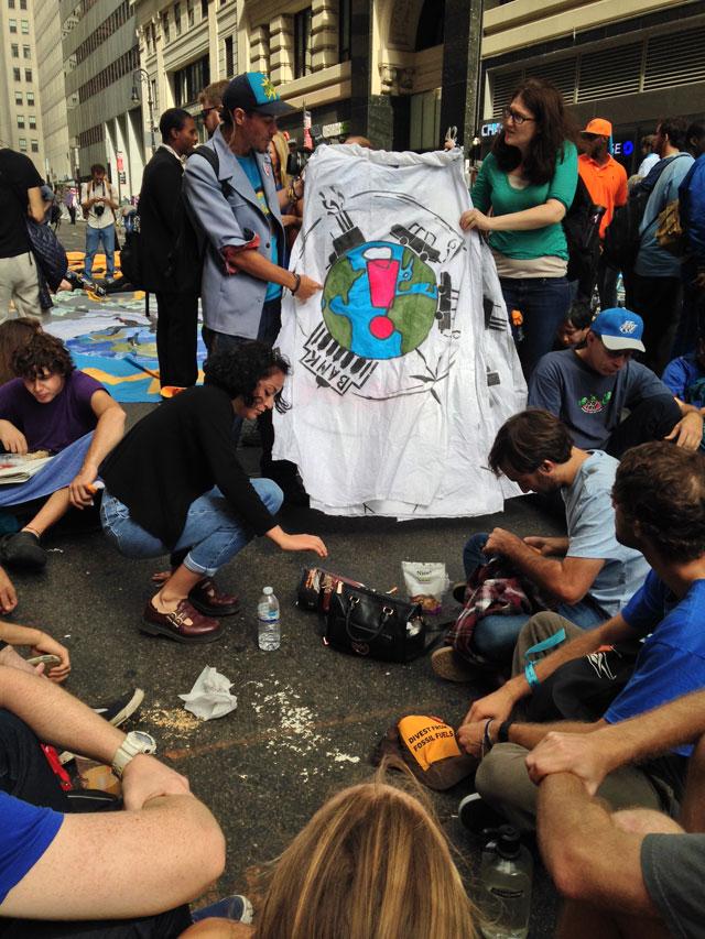Activist street theater (photo by Mostafa Heddaya/Hyperallergic)