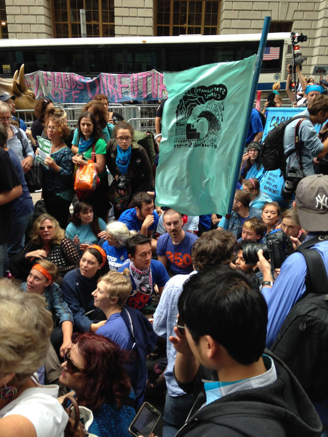 Protesters sitting down on Broadway (photo by Mostafa Heddaya/Hyperallergic)