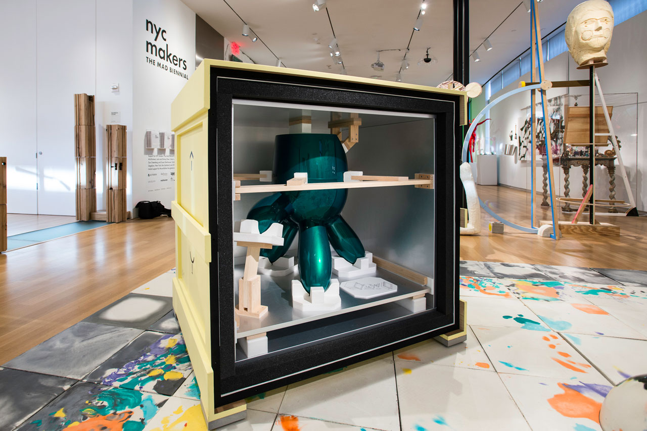 """Installation view, 'NYC Makers: The MAD Biennial' at the Museum of Arts and Design, 2014, with detail of """"Custom Museum Crate"""" (2014) by Boxart and of """"Which Side Up Table"""" (2008) by Wendell Castle, within the museum crate (photo by Eric Scott)"""