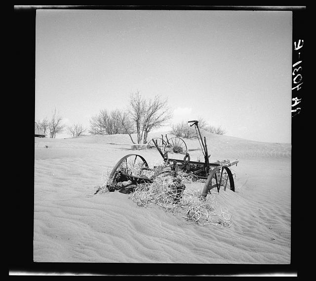 Farm machinery buried in drifting soil, Cimarron County, Oklahoma, photograph by Arthur Rothstein (April 1936) (via Photogrammar/Library of Congress)
