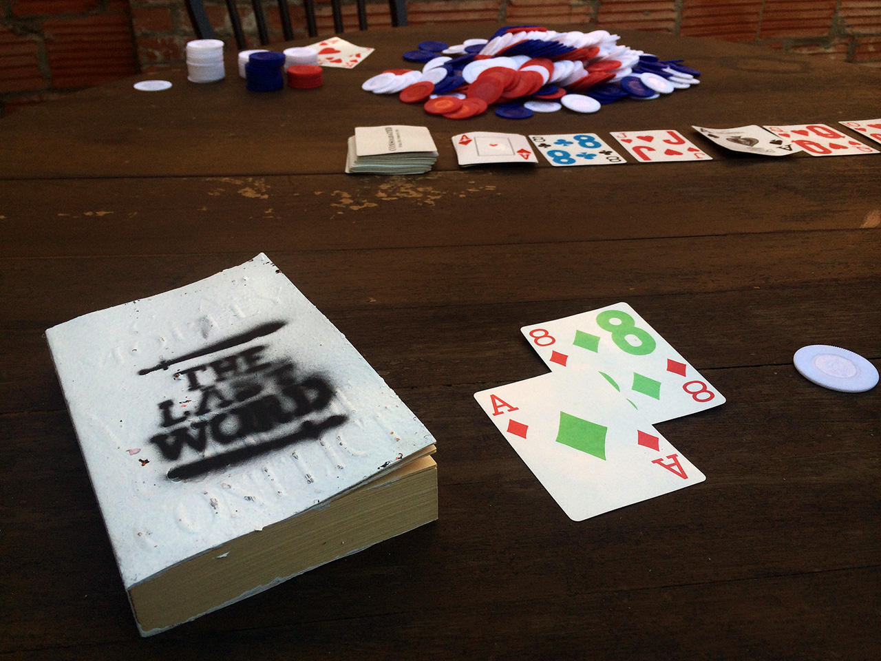 On the poker table inside the saloon