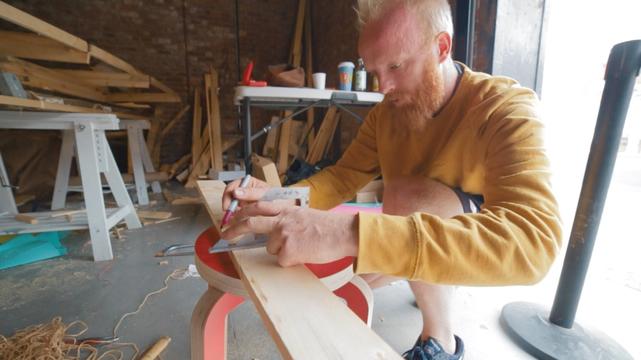 James Bowthorpe building his boat in Red Hook (photo by  Alex Colby)