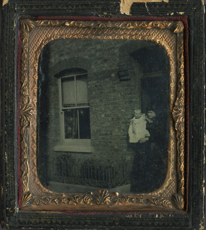 Anonymous portrait of a woman and child outside house (c. 1885), ambrotype