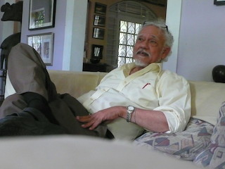 David Boxer, the retired, former director and chief curator of the National Gallery of Jamaica, at his art-filled home in Kingston, Jamaica, September 2014 (Photo by the author for Hyperallergic)