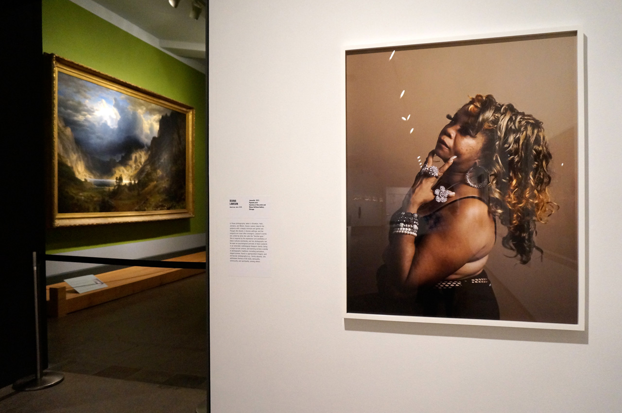 """Deana Lawson's """"Joanette"""" (2013), with a painting in the museum's collection in the background at left"""