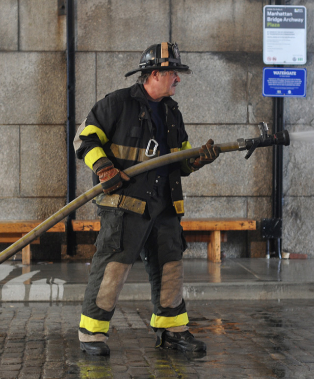 Retired firefighter John Riker performed opposite Dread Scott.