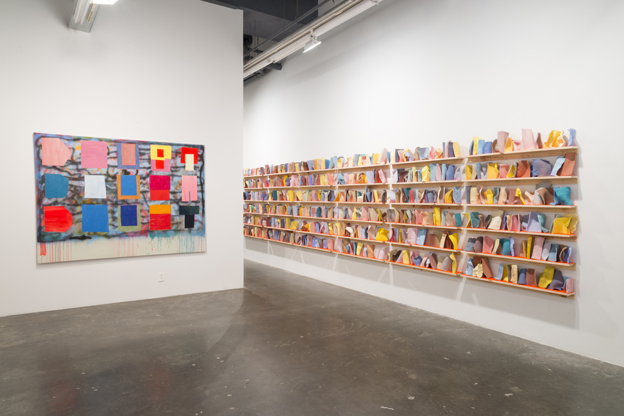 "Installation view, 'Ezra Johnson: It's Under the Thingy,' with ""3 Shelves of Dish Cloths"" (2014) on right"