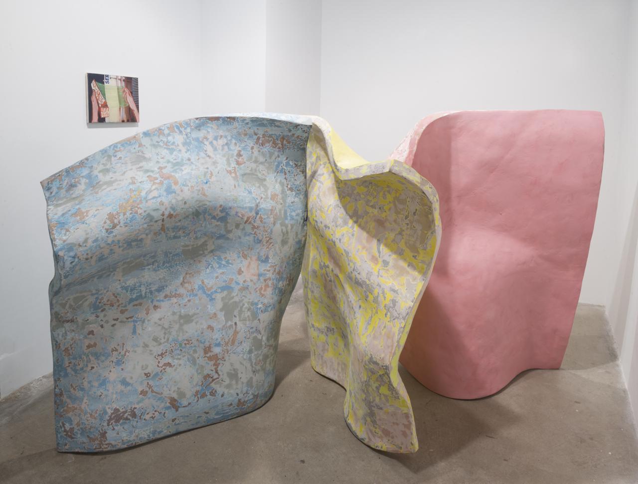 """Ezra Johnson, """"Der, Die, Das Installation Shot"""" (2014), polystyrene, resin, bondo, enamel, 62 x 60 x 72 in, with """"Ser"""" (2011), oil on canvas in the back left"""