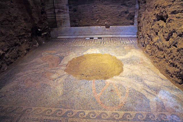 A view of the second chamber mosaic floor and the door to the third chamber at the back