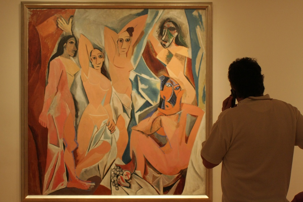 "Man listening to an audio guide in front of Picasso's ""Les Demoiselles d'Avignon"" (photo by peteaylward/Flickr.com)"