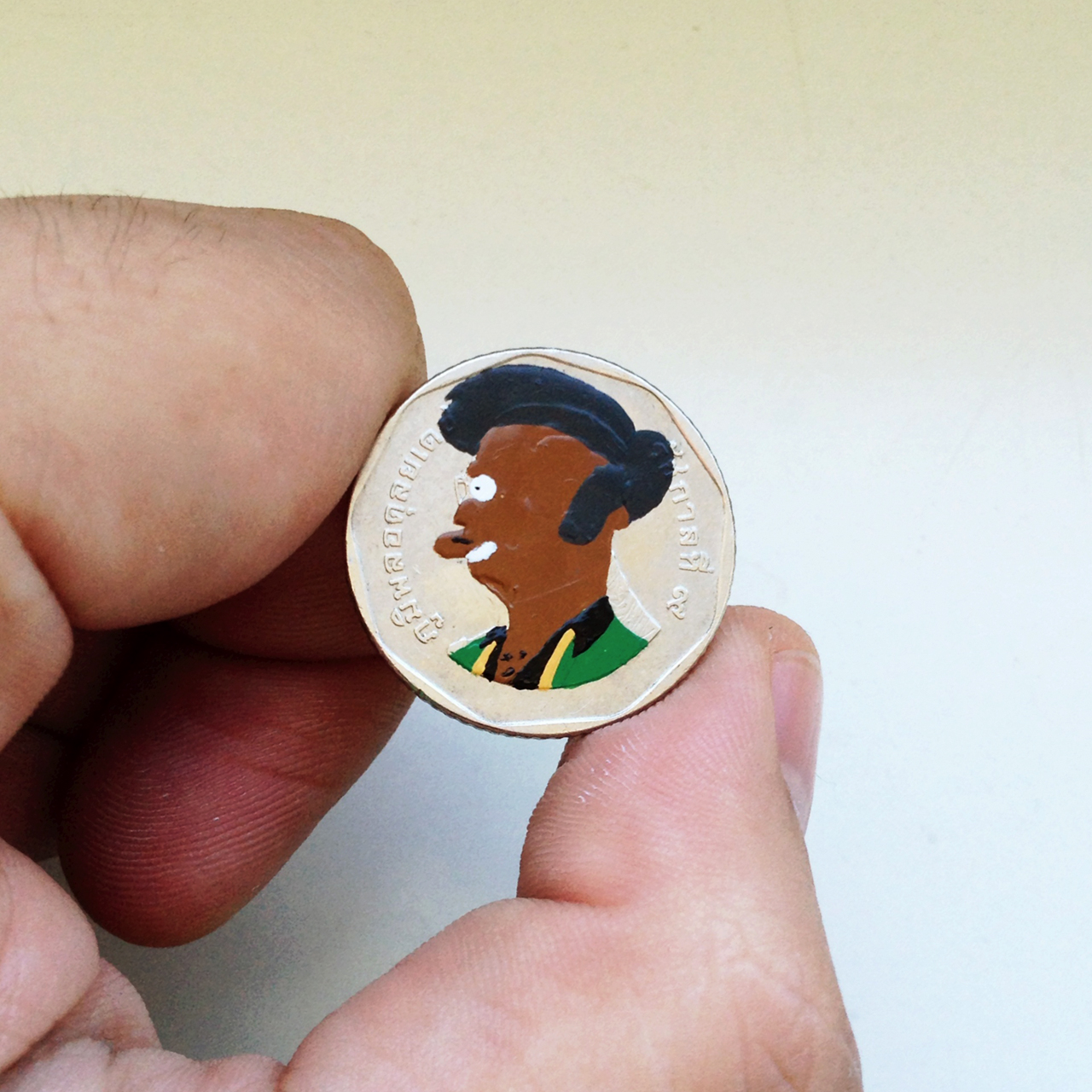 Andre Levy coin painting of Apu Nahasapeemapetilon