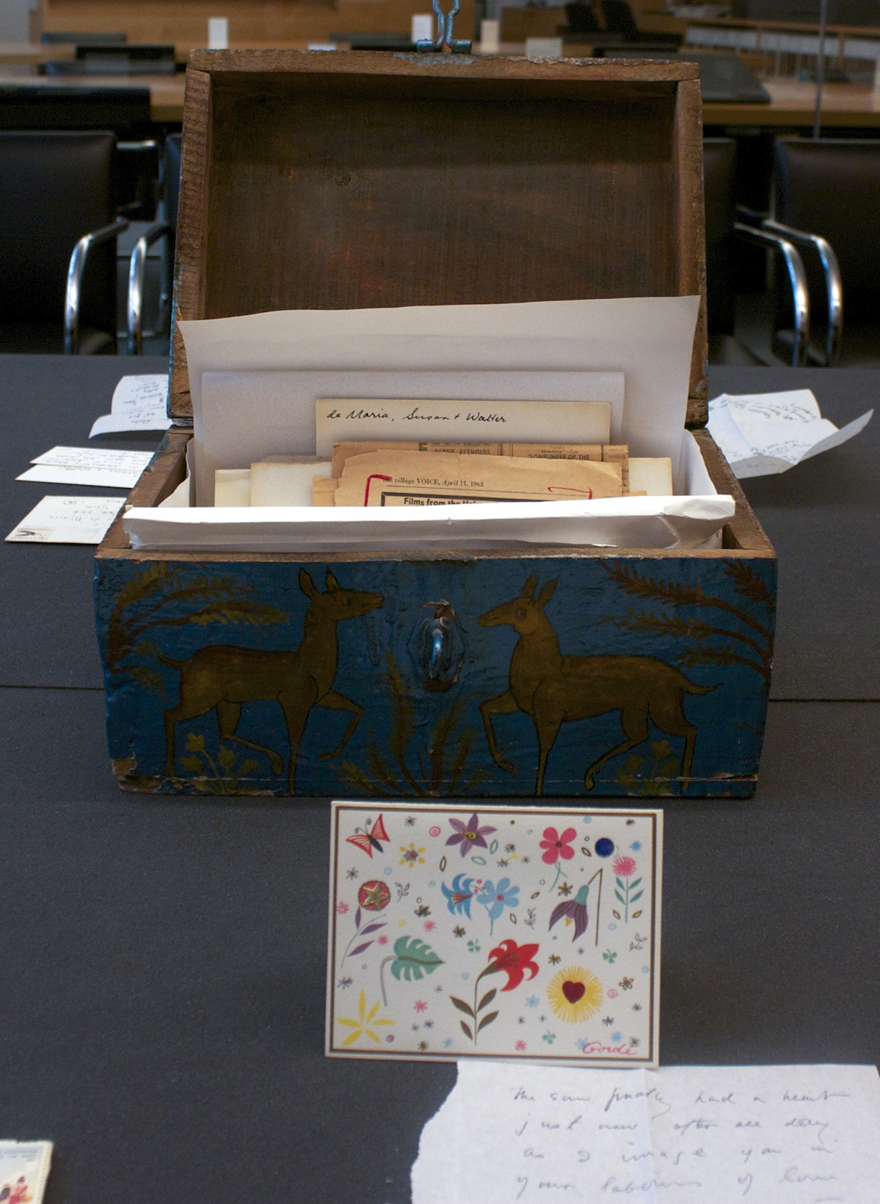 Joseph Cornell saw this wooden box in a Manhattan flea market and gave Susanna De Maria Wilson the money to purchase. It holds his correspondence, and in front of the box is a card dated March 20, 1963. (Image courtesy of the Getty Research Institute, Los Angeles)