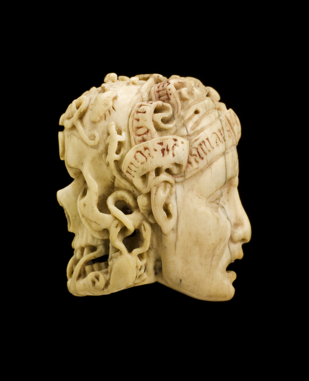 Ivory carving of a skull covered with worms and a human face (via Science Museum, London/Wellcome Images)