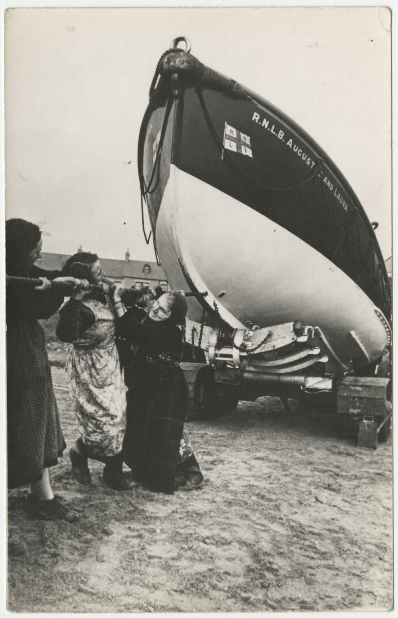 Women pulling a ship