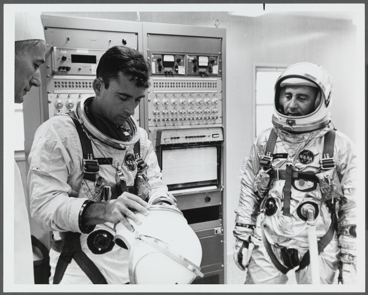 """Norman Rockwell, """"Reference photo for The Longest Step (Grissom & Young Suiting Up)"""" (1965)"""