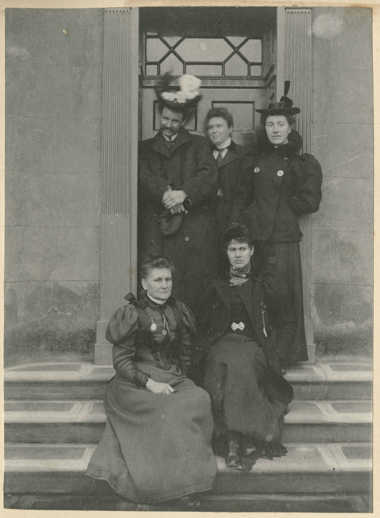 A hatted group on steps (all photographs courtesy Woodhorn Museum and Northumberland Archives)
