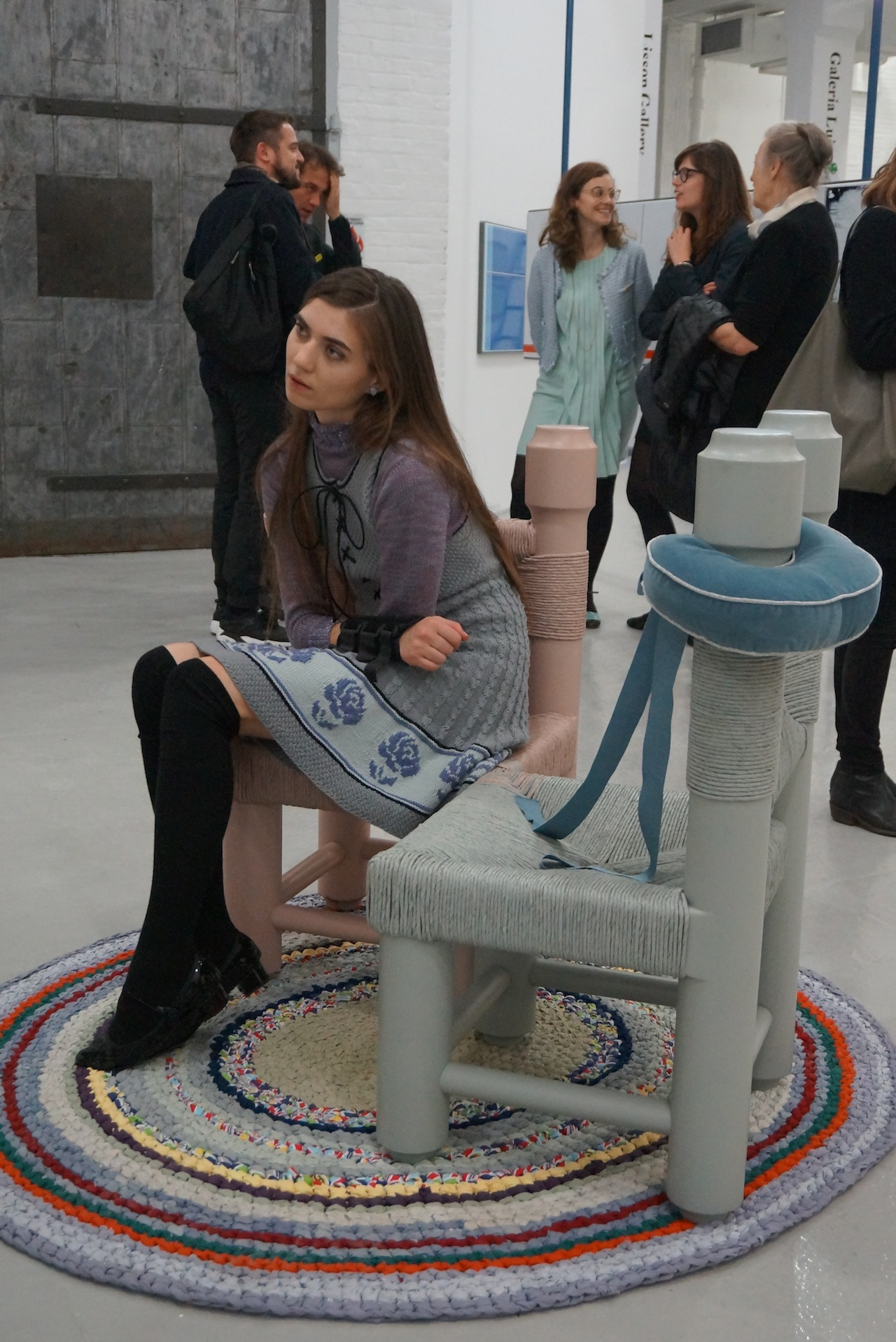 A woman rests on a chair by Bunny Rogers, at Société.