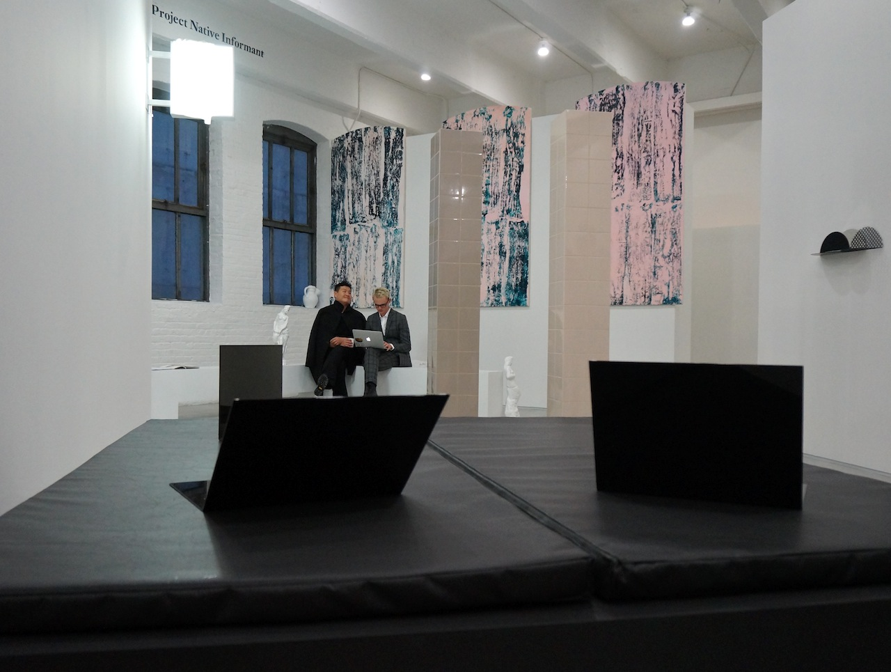 Work by Prem Sahib, at Gallerie Lorcan O'Neill and Southard Reid's shared booth, in the foreground, and Emanuel Röhss at Project Narrative Informant in the background