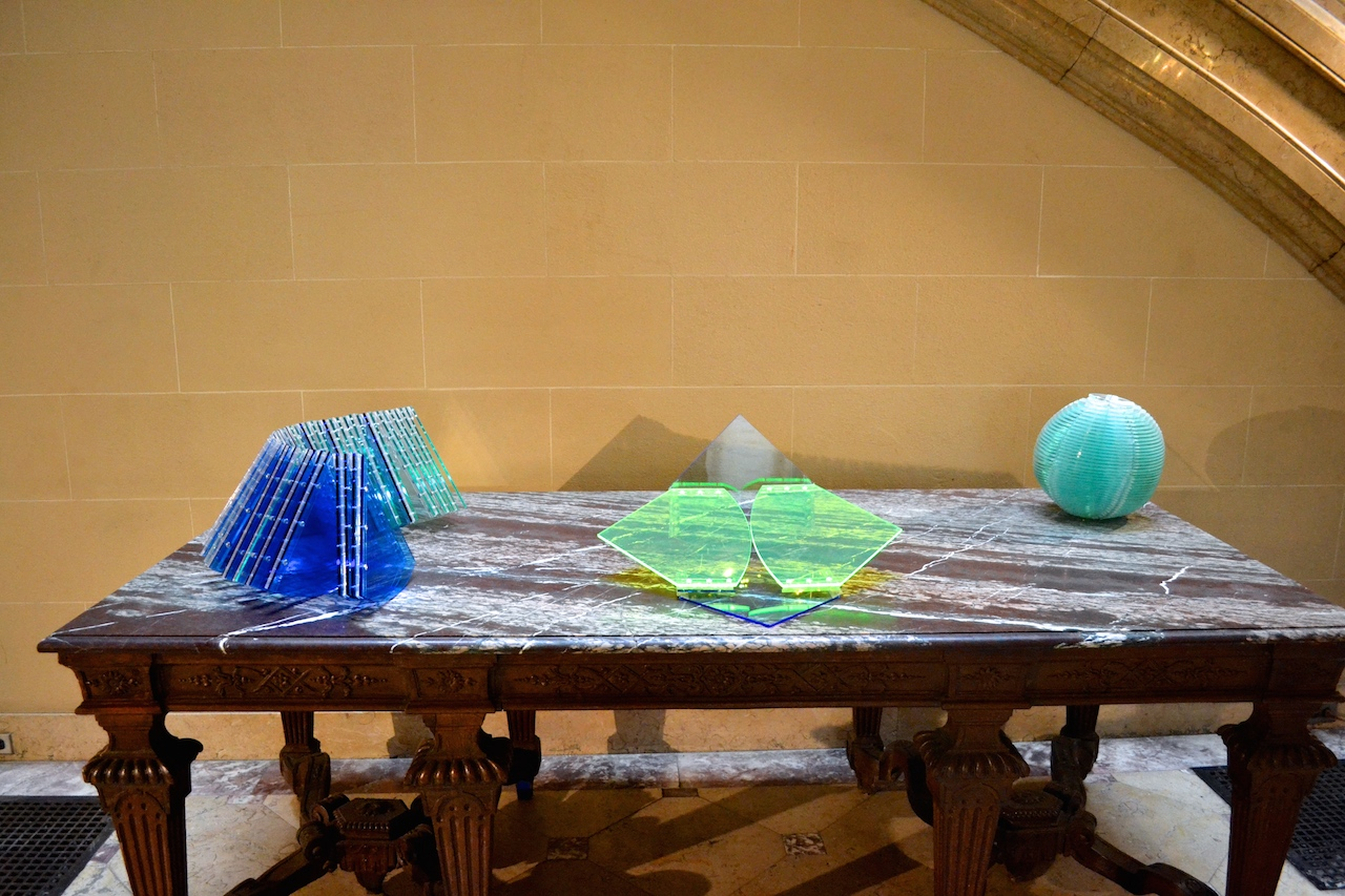 """From left: Marta Chilindron """"Helix"""" (2011), acrylic, dimensions variable, closed: 9 ½ x 11 x 25 in; """"Convertible Circle"""" (2009-2014), acrylic, dimensions variable, diameter: 24 in; """"Sphere"""" (2008), acrylic, dimensions variable, diameter: 12 in"""