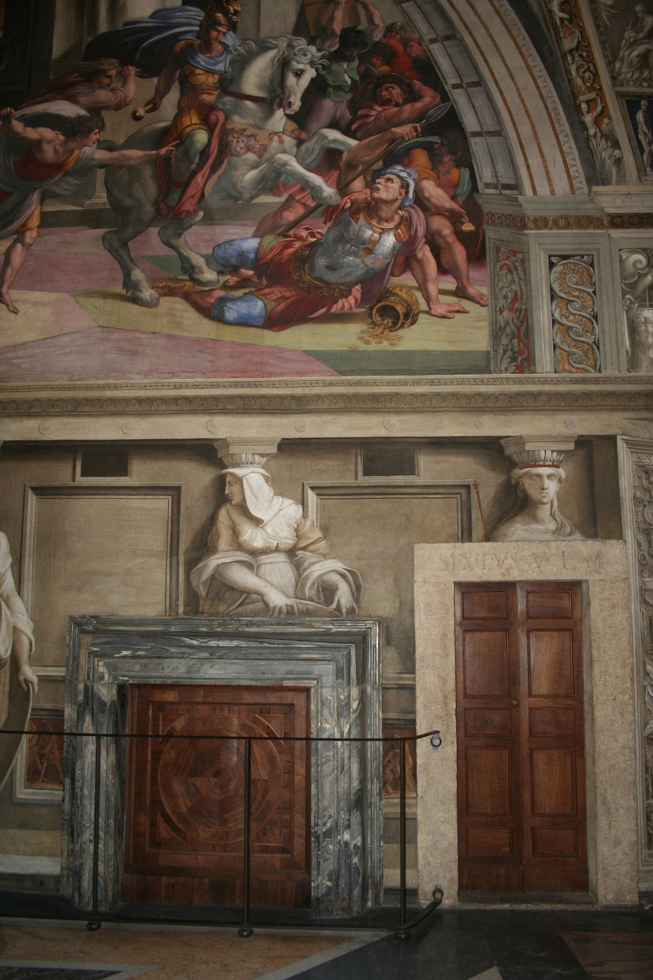 """Rome, Vatican Palace, Heliodorus room, view of the marble chimney located under Raphael's fresco, """"Expulsion of Heliodorus from the Temple"""" (1511–12) (photo © Charlotte Guichard, reproduced with the permission of the Vatican Museums)"""