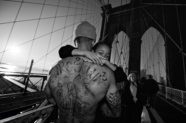 Jerell Williams carrying Fidel on the Brooklyn Bridge