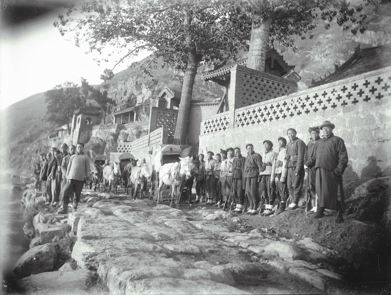 Longmen, Freer's Chinese assistants along the riverbank, November  12, 1910  Yütai (active early 20th century)  Silver gelatin photographic print; H x W: 15.6 x 20.7 cm  Charles L. Freer Papers, Freer Gallery of Art and the Arthur M. Sackler  Gallery Archives, FSA A.1 12.5.GN.088
