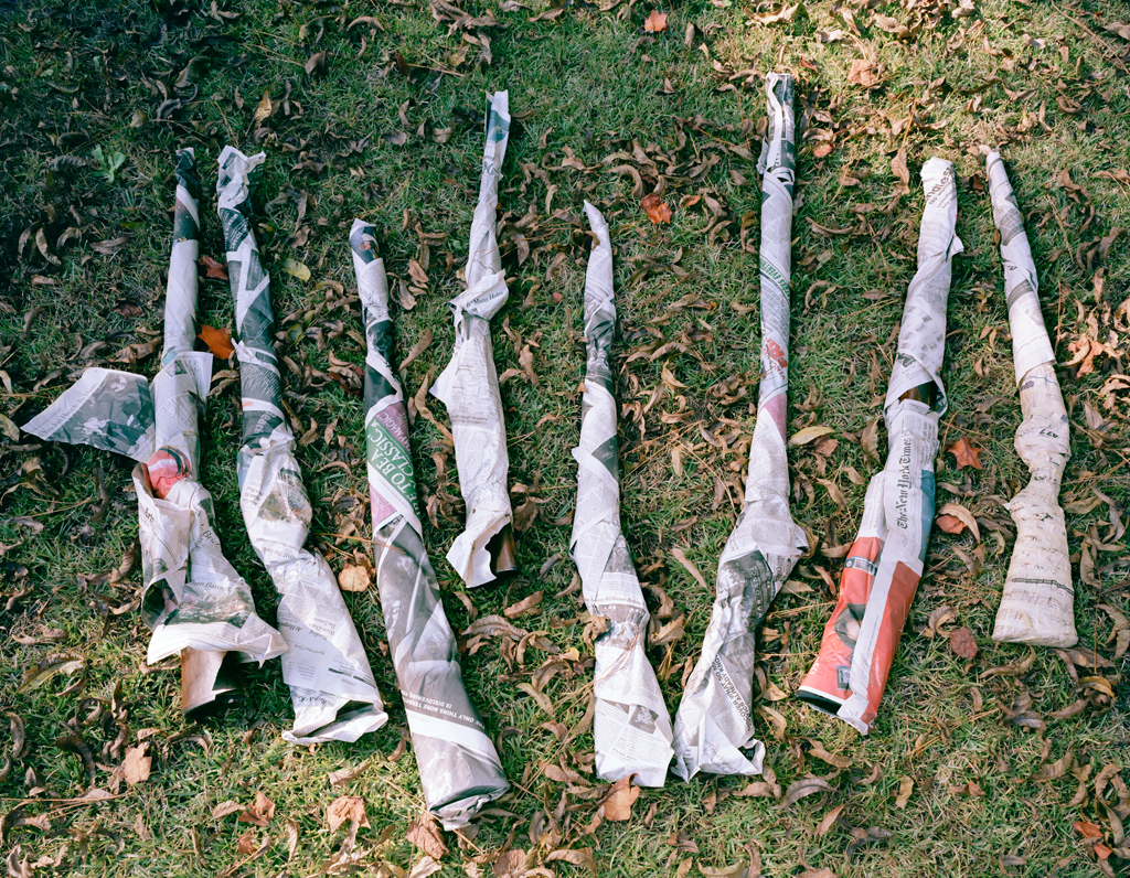"McNair Evans, ""Confessions for a Son,"" showing shotguns wrapped in newspaper"