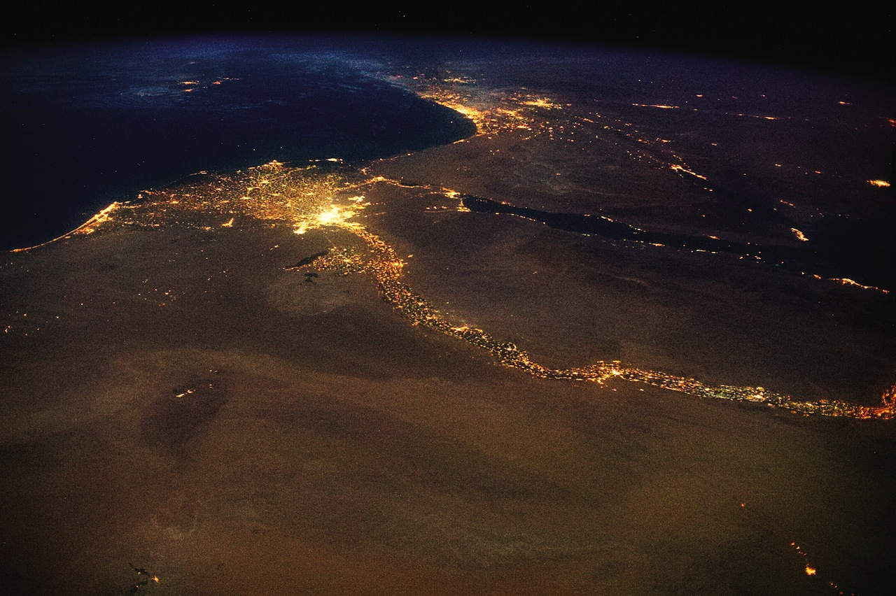 The End: The Nile, draining out into the Mediterranean. The bright lights of Cairo announce the opening of the north-flowing river's delta, with Jerusalem's answering high beams to the northeast. This 4,258 mile braid of human life, first navigated end-to-end in 2004, is visible in a single glance from space