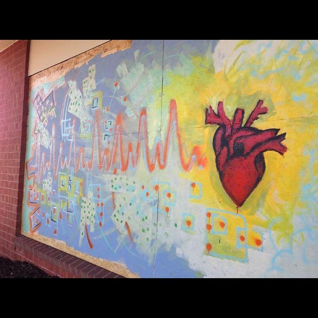 Mural in Ferguson (image via paintforpeacestl/Instagram)