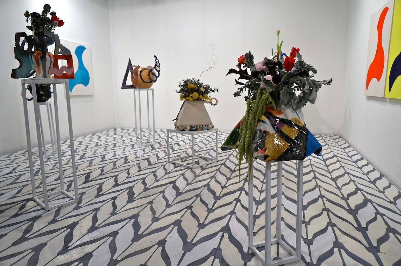 Travesia Cuatro's booth, filled with work by