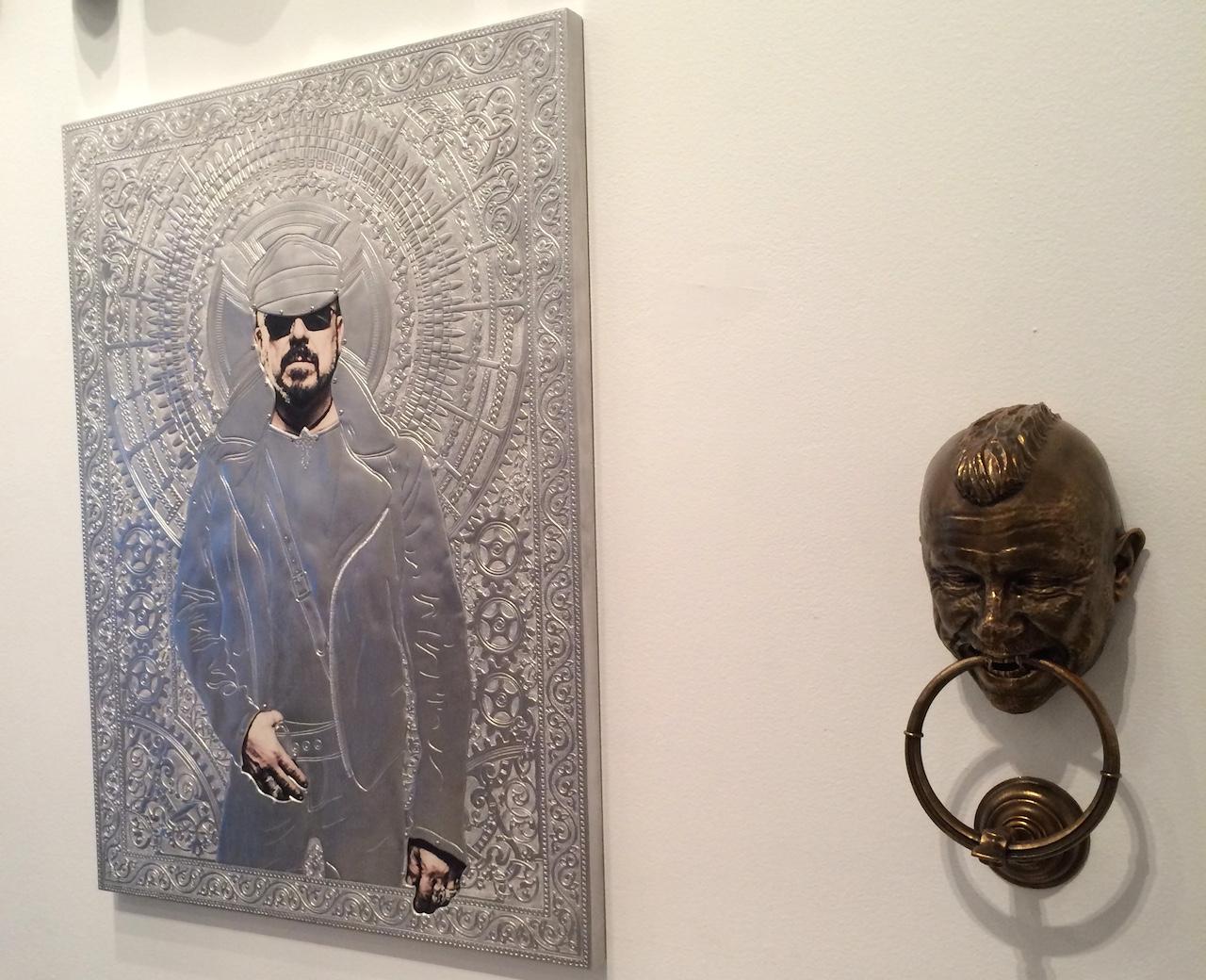 "Wim Delvoye's ""Icon (Peter Marino)"" (2013) and ""Door Knocker (Peter Marino)"" (2014) in 'One Way: Peter Marino' at the Bass Museum of Art"