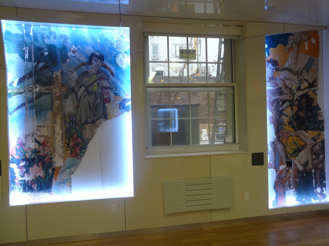 """What remains of George Whitman's mural """"Adam and Eve"""" in the LGBT Center's Kaplan Assembly Hall"""