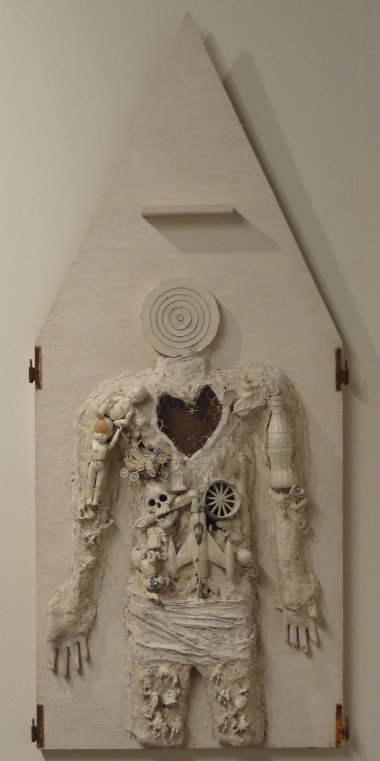 "Niki de Saint Phalle, ""Assemblage (Figure with Dartboard Head)"" (circa 1962)"
