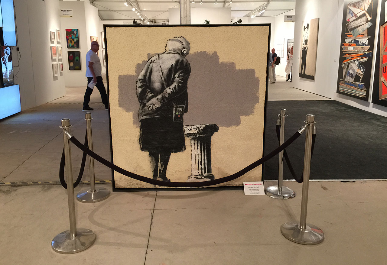 """One of the fastest wall to art fair transitions for a Banksy art work yet happened this fall when """"Art Buff,"""" which appeared in the UK this past September, was already on display at the 2014 Art Miami fair courtesy  (photo Hrag Vartanian/Hyperallergic)"""