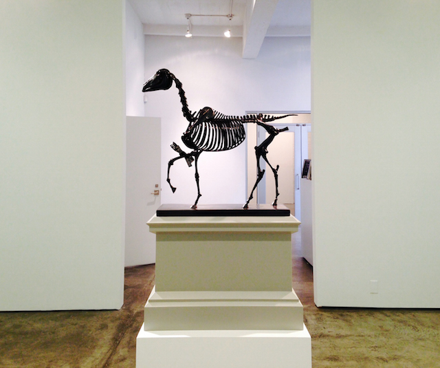 """Hans Haacke, """"Gift Horse, Model for Fourth Plinth, Trafalgar Square, London"""" (2013). Bronze and electroluminescent film; sculpture: 18 1/8 x 16 x 6 1/4 inches; plinth: 13 x 8 1/2 x 18 in.; overall: 30 1/2 x 8 1/2 x 18 inches. Edition 2 of 6; 1 AP. Fabricated by Julia and Shane Stratton. (all images by the author for Hyperallergic)"""