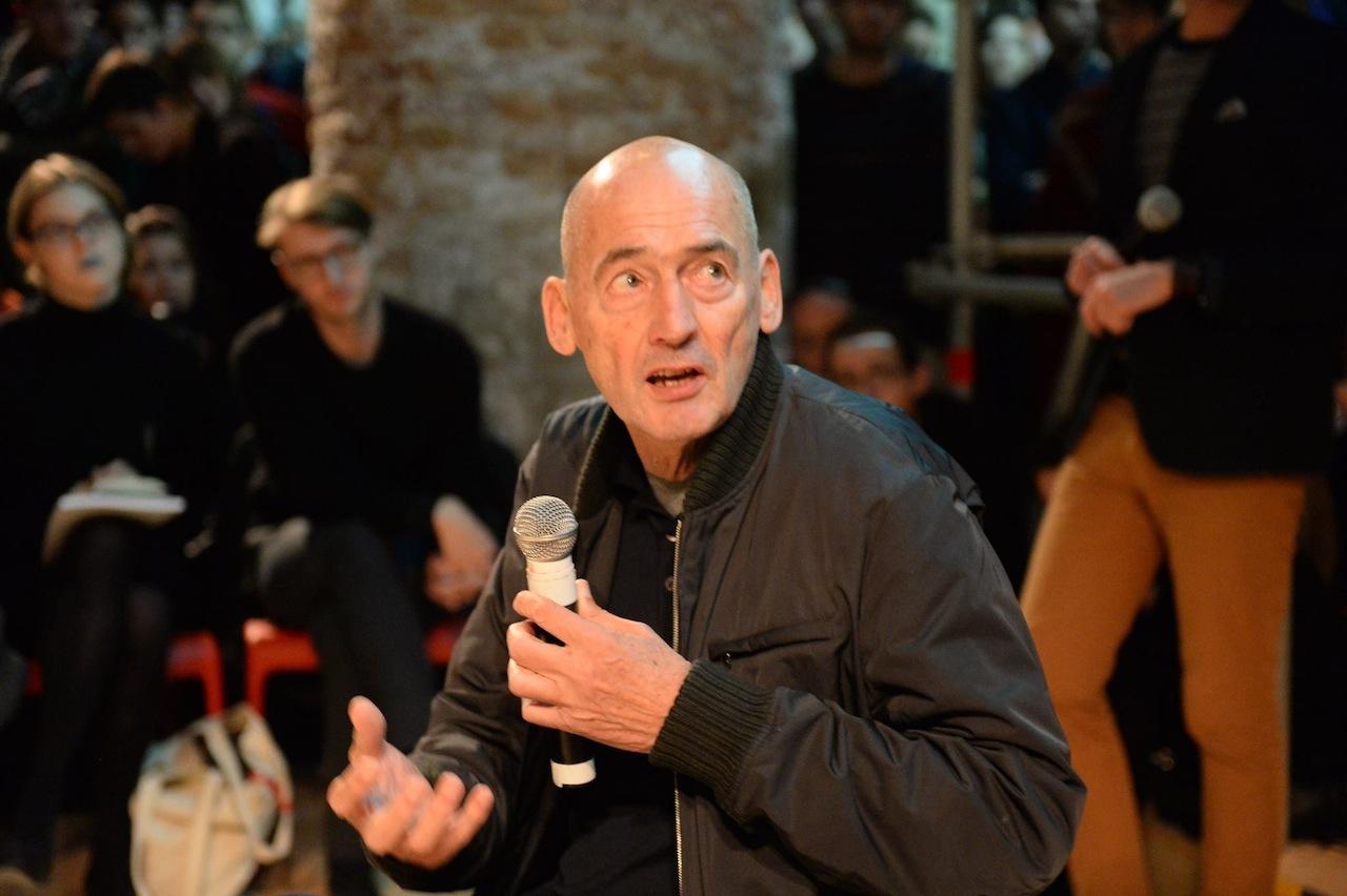 Rem Koolhaas speaking at the 2014 Venice Architecture Biennale (Image via Facebook)