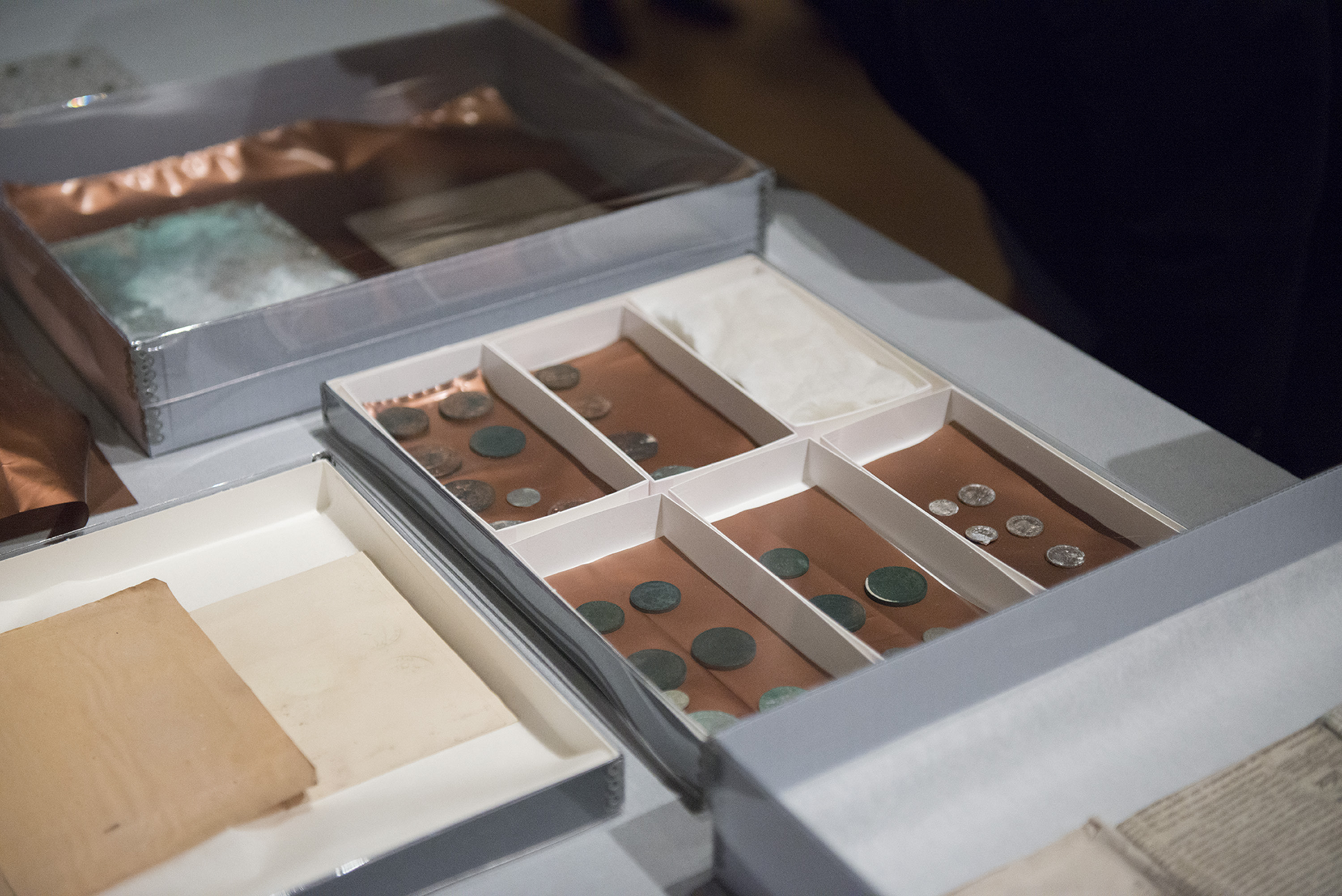 Contents of a time capsule found in the cornerstone of the Massachusetts State House building and undergoing examination and conservation work at the Museum of Fine Arts, Boston. January 6, 2015 (Photo courtesy of Museum of Fine Arts, Boston)